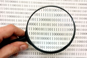Picture of magnifying glass over binary data
